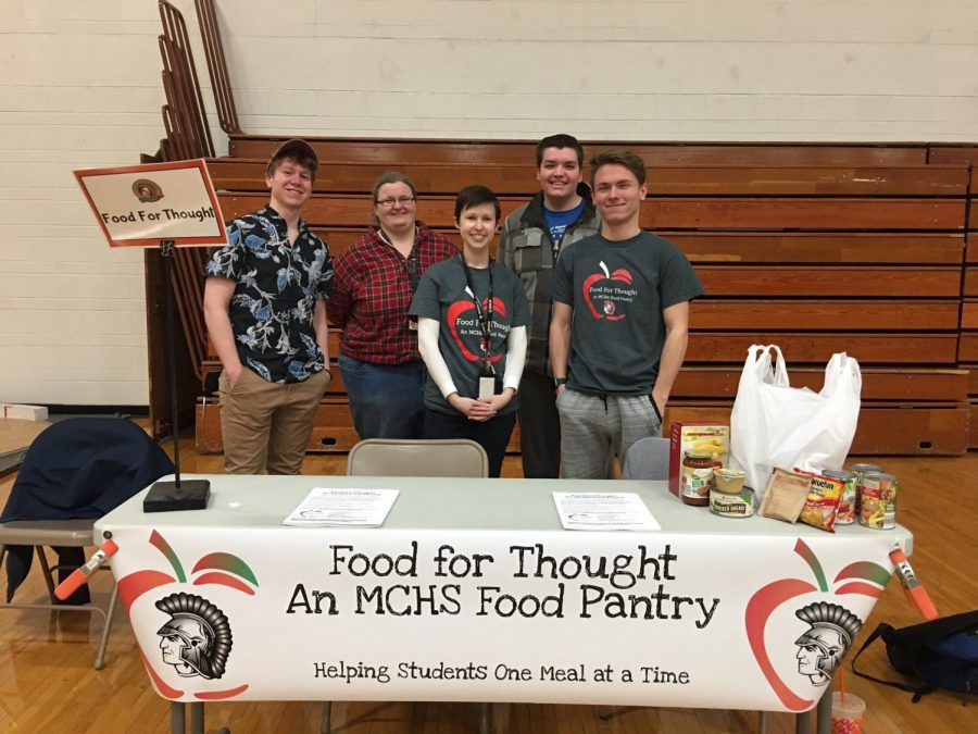Teachers Ashley Diedrich and Emma Theel promote the Food For Thought Program with some of their student members at the Freshmen Extravaganza in February.
