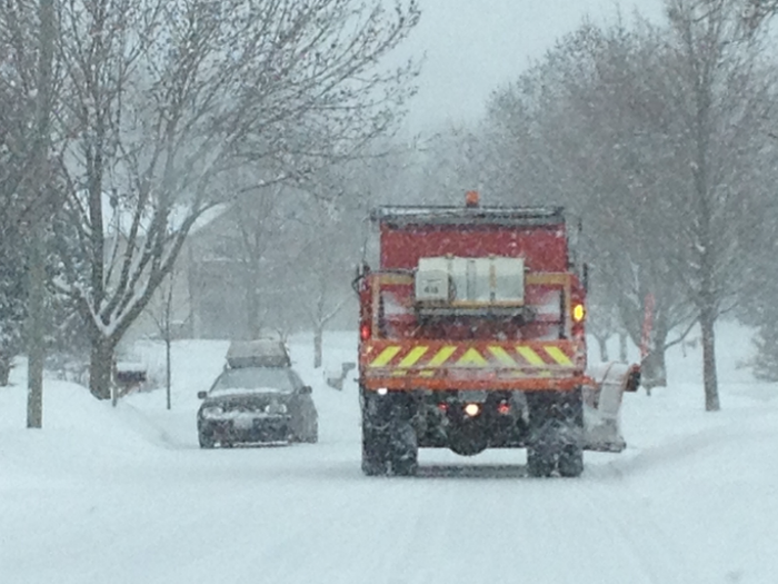 A snow plow clears a snowy thoroughfare in McHenry this winter.
