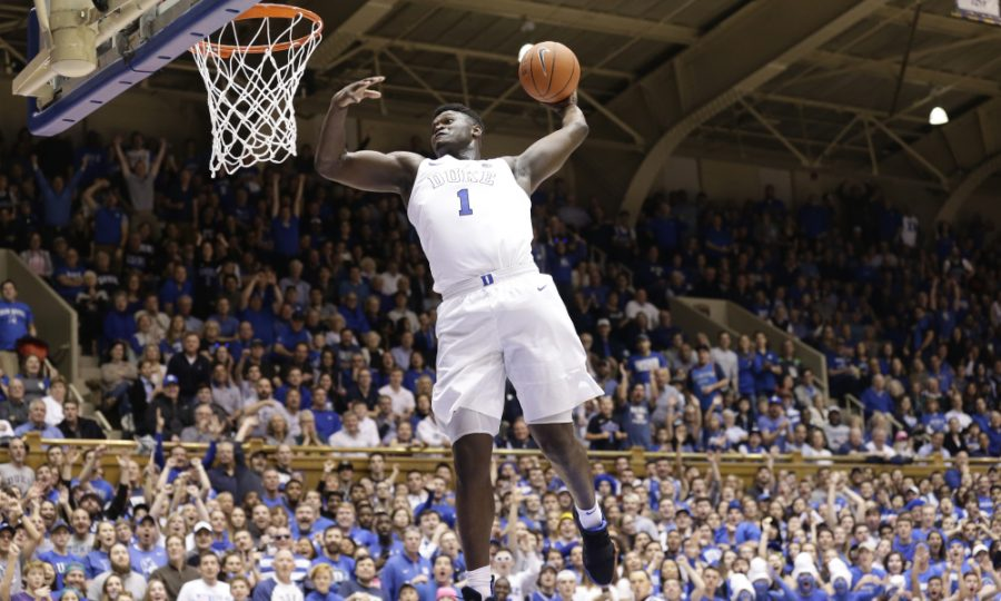 Forward+Zion+Williamson+of+Duke+University+%281%29+rises+up+for+a+slam+dunk.+