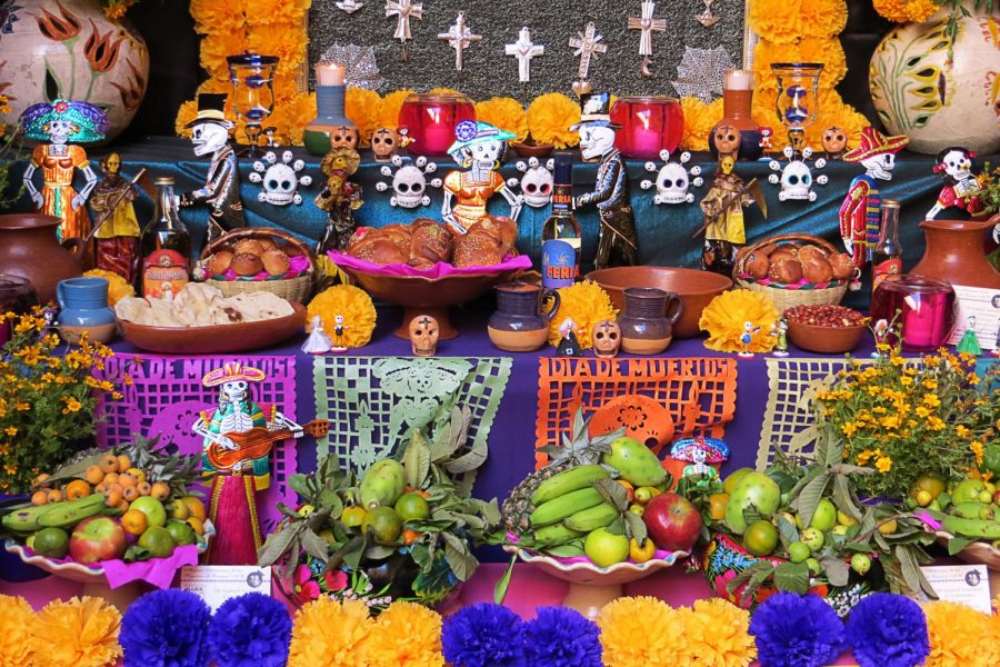 People who celebrate the Day of the Dead often create altars like this one in Oaxaca, which is decorated with candles, flowers, and the favorite foods and drinks of those who have passed.