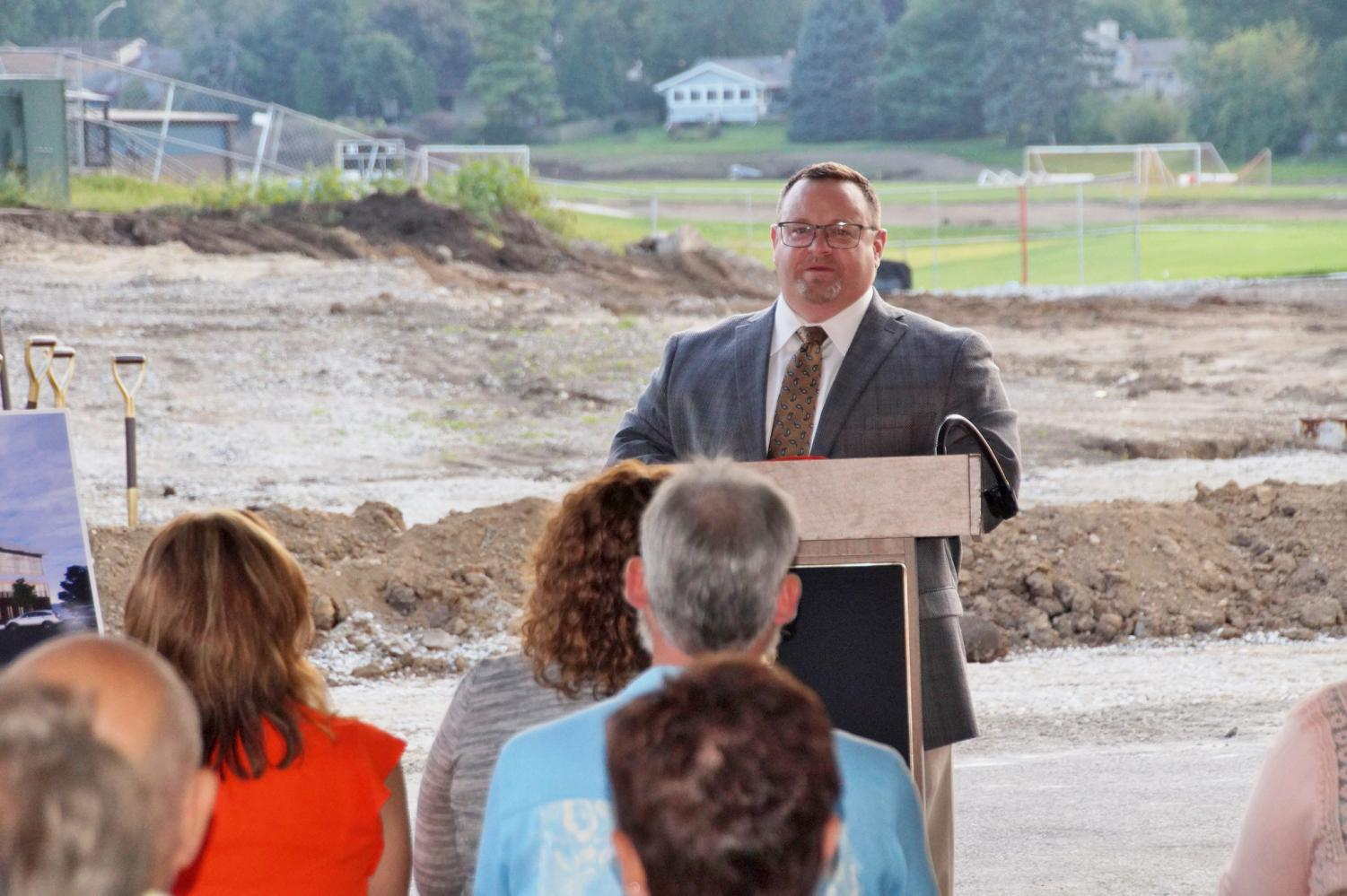 Assistant Superintendent of Curriculum and Instruction Carl Vallianatos addresses stakeholders during a groundbreaking ceremony on September 19 outside of West Campus.