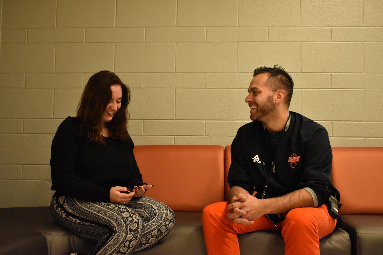 Justin Stroh smiles as he converses with senior Stacy Correra outside of the classroom. One of Stroh's main goals as dean is to establish a more positive relationship with students across both campuses.