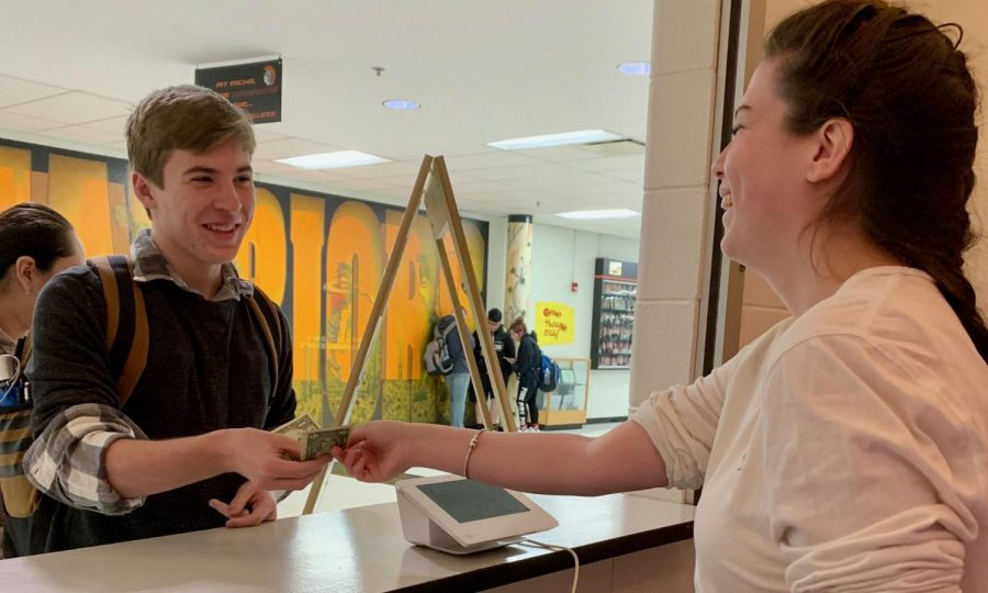 Natallia Anderson serves a student at the Hidden Pearl, a local coffee shop that has teamed up with West Campus to serve drinks during the first few class periods of each school day.