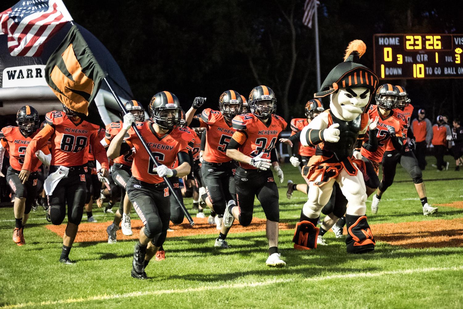 Leonidas leads the Warriors onto the football field during the 2018 Homecoming game against Cary-Grove on September 28. The 2019 team went into Homecoming with a record of 3-2.