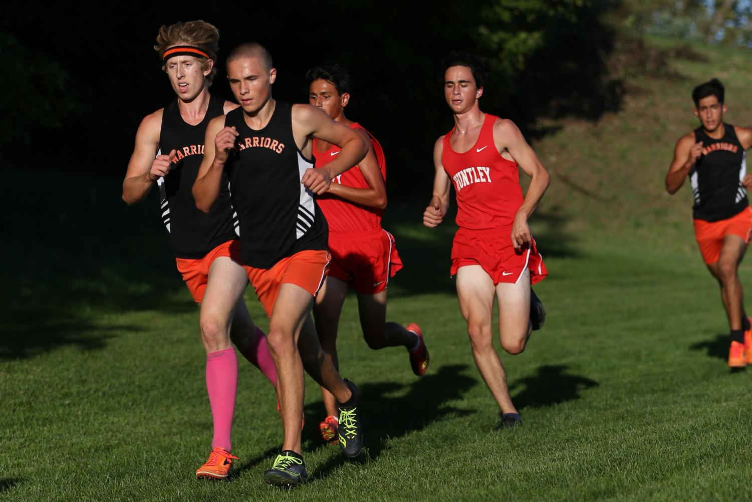 Junior Caleb Schopen and Seniors Ian Knebl push ahead of their Huntley opponents during a cross-country meet on September 24 at McHenry Township Park.