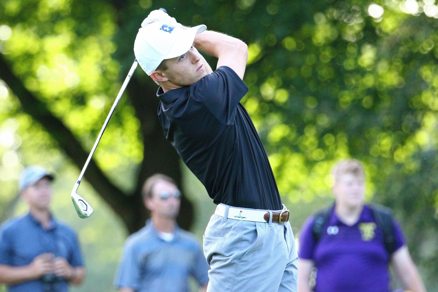 Truman Keppy swings his golf club during the first boys golf game of the season against Wauconda on August 15.
