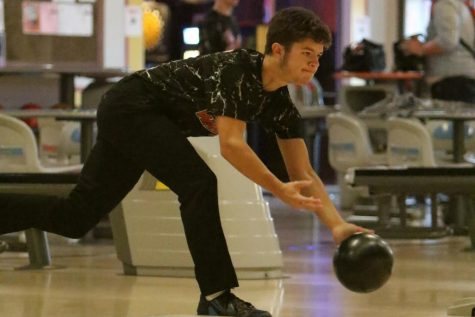 Senior Jacob McLean practices with the boys bowling team in December of 2018 at Raymond