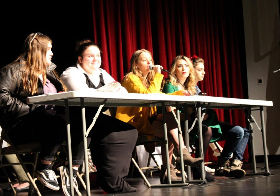 Speaking at last years Chautauqua event, now-senior Allie Jacobsen calls on audience members to discuss political topics on November 15 in the West Auditorium. Jacobsen was the chairperson alongside fellow classmate panelists.