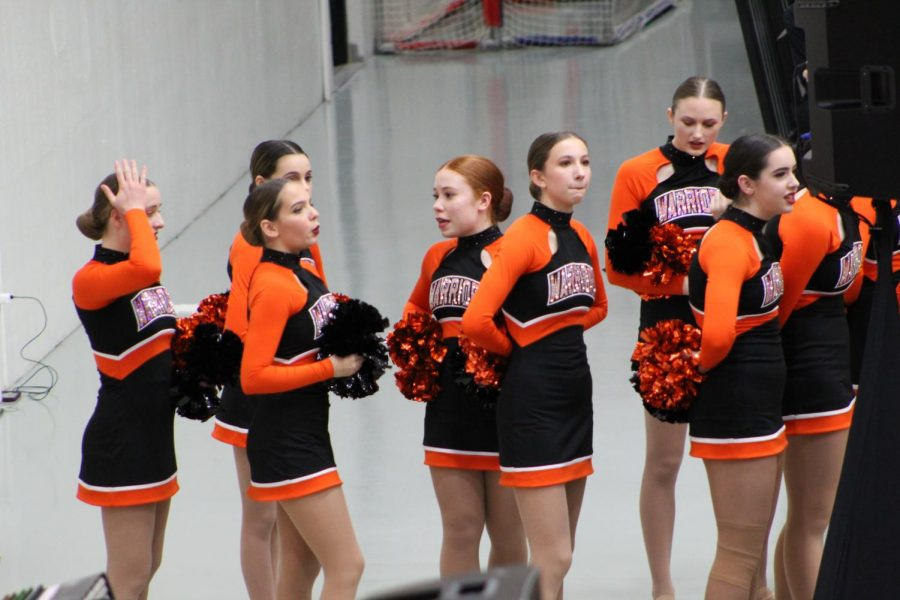 MCHS's varsity dance team waits their turn to hit the gym floor. The dance team hosted the Fox Valley Conference championship at West Campus on January 15.
