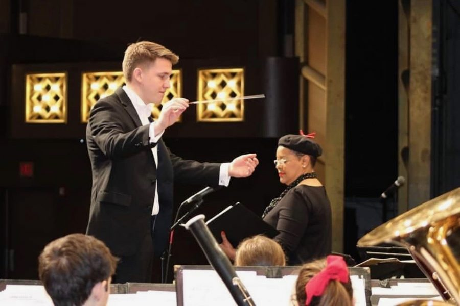 Spencer Hile, director of MCHS bands, leads the symphonic band on February 1 at the Illinois Music Education Conference in Peoria. This was the band's first major statewide recognition for musical excellence.