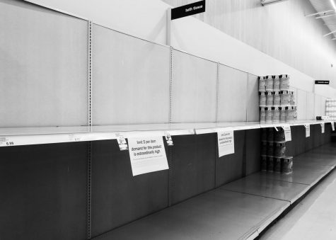 Shelves in the bath tissue aisle at Meijer in McHenry stand bare on March 17. COVID-19 has sent consumers fearful that staples such as toilet paper and eggs will run out