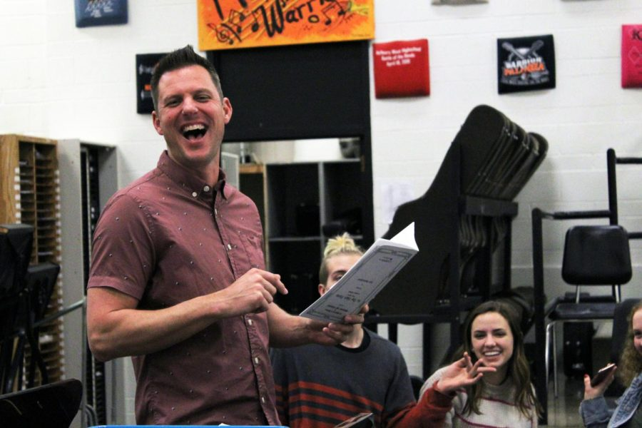 Laughing+with+his+students%2C+Derek+Galvicius+listens+back+to+a+recording+with+his+Surround+Sound+students+on+March+5+in+the+West+Campus+choir+room.+