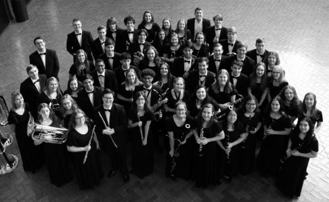 The symphonic band pose prior to their performance at the Illinois Music Education Conference in Peoria on February 1. The band was one of only 16 high school bands in the country selected to perform at National Concert Band Festival in Indianapolis this weekend before the trip was cancelled.