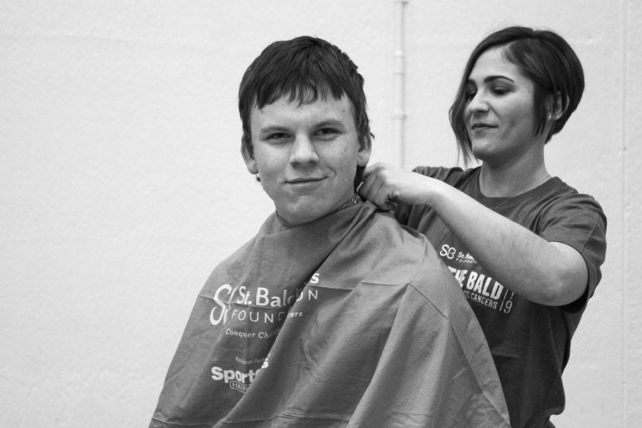 Preparing to lose his hair for charity, Mark Winters sits in a barber stool during 2019's St. Baldrick's Community Shave in the West Campus Main Gym on March 21. This year's event, which annually brings the broader McHenry community together, has been cancelled due to coronavirus concerns.