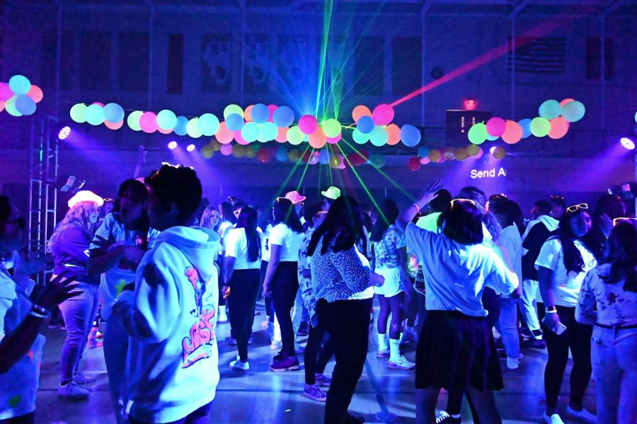 Students dance beneath the neon lights at this year's MORP dance, which took place on February 15 at East Main Gym. The theme of this year's dance was