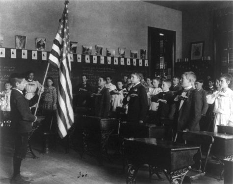 Students in the United States pledged their allegiance to the American flag well before 1942, when Congress formally adopted the Pledge—even as early as 1899, as in this image. In more modern times, students question whether the Pledge should be a required part of their day.