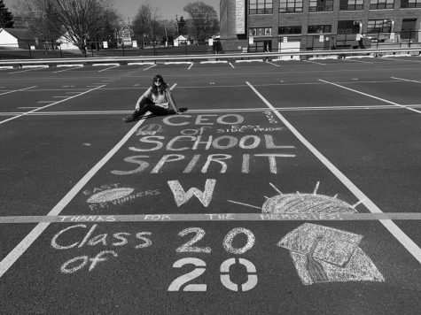 Waiting to hear the verdict on the rest of her senior year, Senior Gracee Majkrzak draws on her East Campus parking spot.