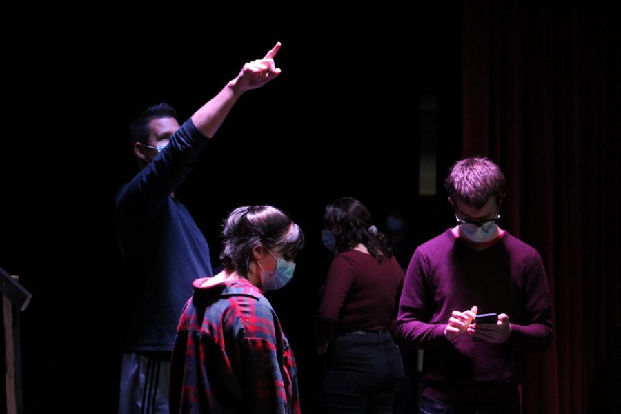 Derek Galvicius gives lighting instructions while Alayna Majkrzak and David Henry look over their lines during a rehearsal for