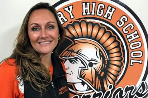 Hilary Agnello poses with the McHenry High School Warriors logo. Agnello is the Varsity volleyball coach, a math interventionist, and a teacher on special assignment.
