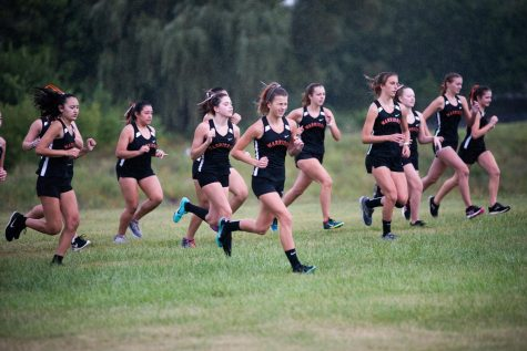 The girls cross country team competes in a race against Dundee-Crown on September 10 at West Campus.