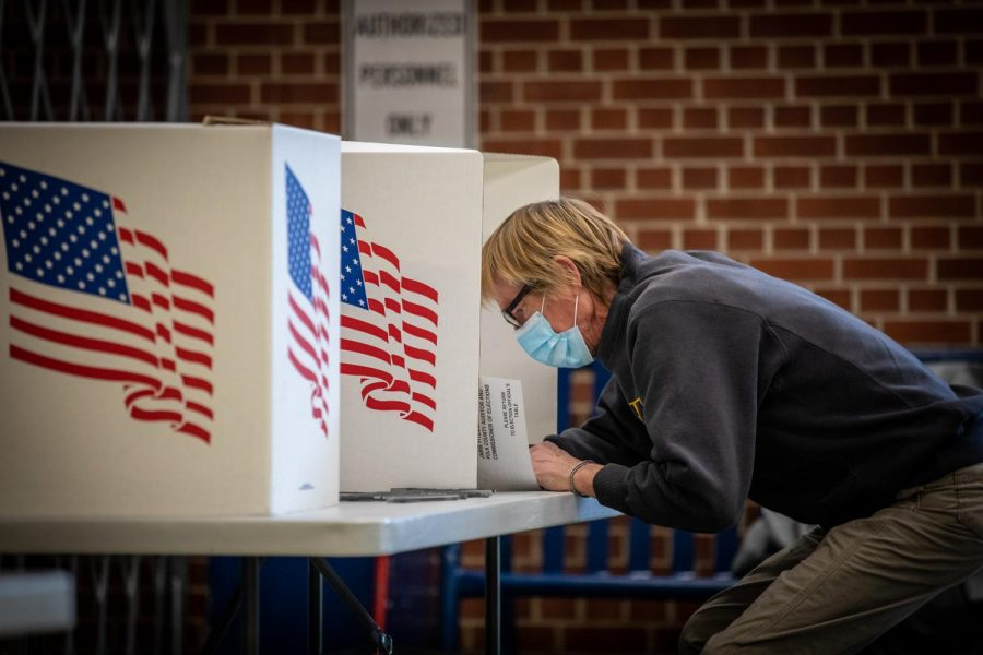 Voters in Des Moines precincts 43, 61 and 62 cast their ballots at Roosevelt High School on November 3. Poll workers around the country, including in McHenry County, helped ensure that Election Day go more smoothly than many expected.