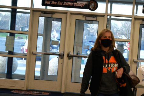 CTE division chair Karyn Burmeister walks into West Campus wearing a mask on November 20. As cases in McHenry County rise, staff rely on clear information to decide whether to work from their classroom or from home.