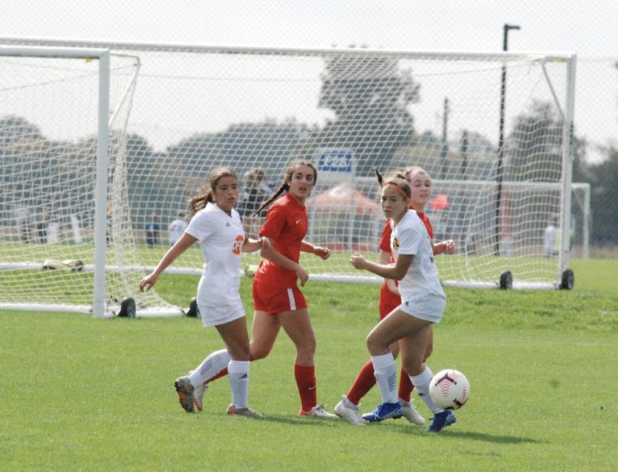 Sophomore Mara Torres plays with her travel game during a soccer tournament this summer despite concerns about COVID-19. With IHSA sports paused or changed, athletes and their have to carefully consider whether to continue travel sport