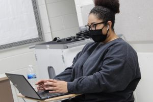 A student sits on her Chromebook during an in-person class at West on January 27., one week after MCHS back from a semester fully remote.