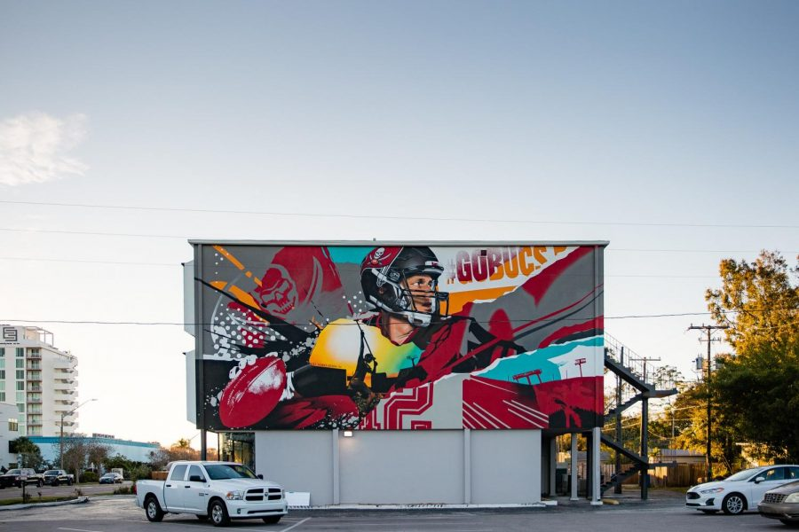 A billboard in St. Petersburg, FL painted by the Vitale Brothers honors the career and history of Tom Brady, quarterback of the Tampa Bay Buccaneers who will lead the team to his tenth Super Bowl appearance on Sunday.