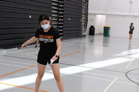 Gisselle Sandoval serves the birdie over the net during a badminton practice on February 16 in the West Campus Main Gym. The team's first match takes place on February 22.