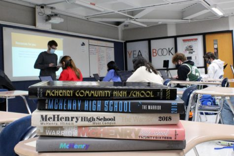 A stack of MCHS yearbooks sit in Mitch Stengel