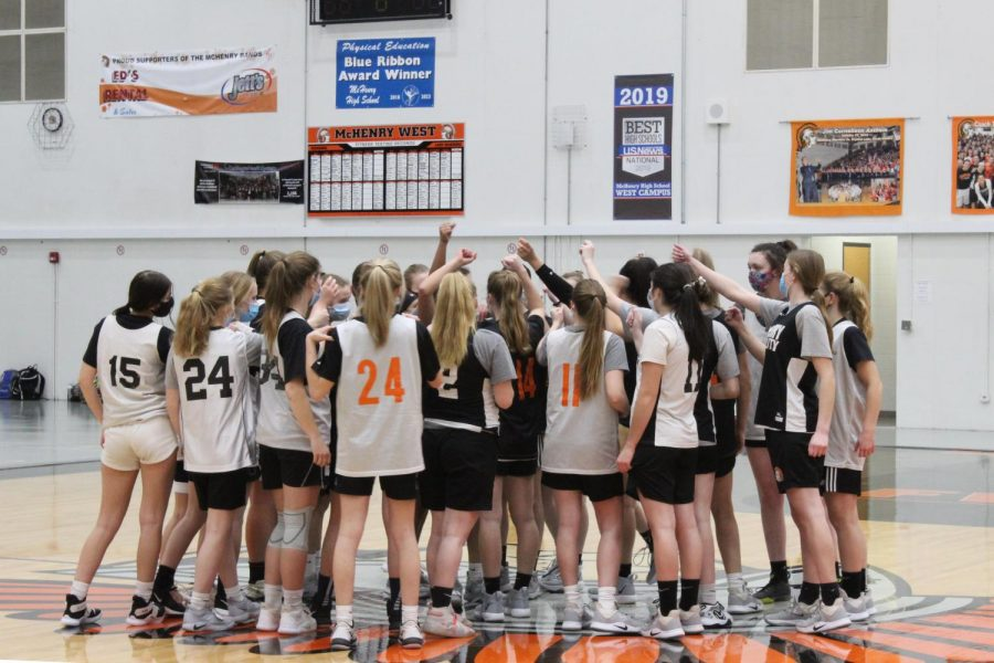 The varsity girls basketball team cheers together during a practice in the West Main Gym on February 2.
