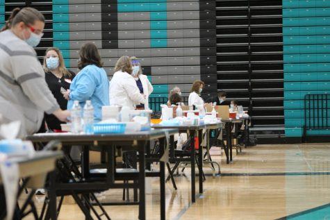 Nurses reset injection stations set up at Woodstock North High School on February 12 after a wave of MCHS teachers, staff members, and administrators received their first dose of the COVID-19 vaccine.
