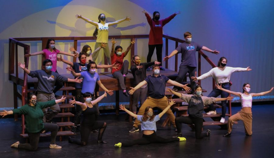 Dancers and singers from this year's musical revue  pose at the end of a  song during tech rehearsals. This year's spring musical will take special precautions to ensure a safe performance, such as masks and social distancing.