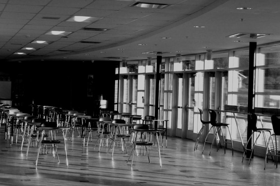 Empty, socially distant desks wait in the West Campus south foyer for students to sit and eat their lunches — one of many ways the past year felt different to students.