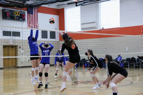 Regina Anelli spikes the volleyball during a home volleyball match on March 22 against Lakes High School.