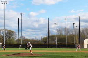 The varsity baseball team played Mundelein on April 15 at Peterson Park.