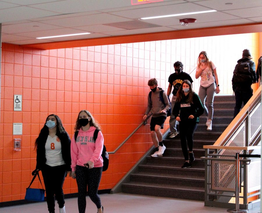 Students move from the fourth floor of the Center for Science, Technology, and Industry to the third between classes on March 22, the first day the new extension was open to students and staff.