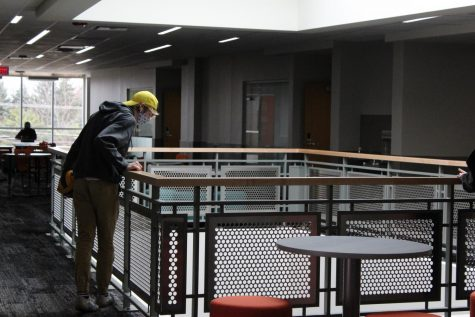 A student looks from the fourth floor to the third floor of the new extension at West Campus on March 22. Called the Center for Science, Technology and Industry, the space accommodates math, science, CTE, and communications classes.