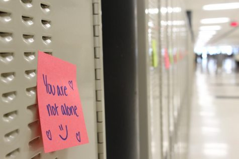 A note on a locker in the hallways at West Campus promotes Start With Hello Week, an initiative promoted by  Student Council to spread positivity during the week of April 5.