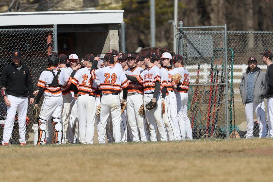 Varsity baseball players cheer for each other before a game during the 2019 season — the last season that the team played. Though COVID shut down last year's season, this year's spring sports will play — just a shorter season that stretches into the summer.