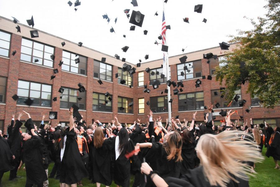 The class of 2018 celebrates following their graduation at East Campus. Because of COVID, cherished graduation traditions have been canceled or adapted to accommodate social distancing, but new traditions, like the senior parade, have been added.