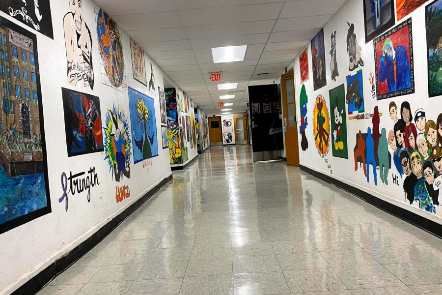 The art hallway at East Campus is currently decorated with murals painted by students across decades — a beloved tradition that has helped shape the identity of the campus.
