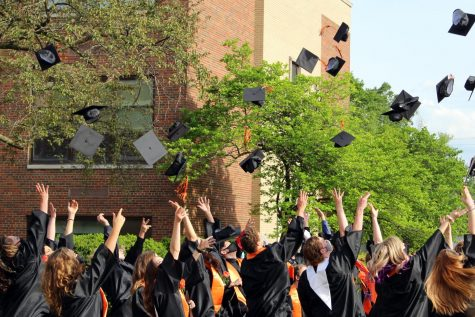 The Class of 2021 tosses their caps following their commencement ceremony on May 20 outside of East Campus. This was one of 14 separate graduation ceremonies held by East Campus.