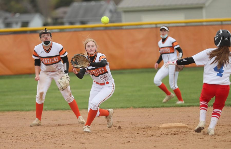 Morgan Sellek catches a throw at second base during a varsity softball game at West Campus on April 14. Softball players are among those who are allowed to play without masks, according to guidance from the IHSA.