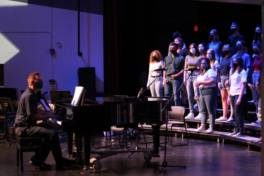 Choir director Derek Galvicius accompanies and conducts MCHSs Concert Choir as they perform their first and last concert of the year in the West Campus auditorium on May 6.
