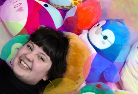 Ciara Duncan poses with her collection of Squishmallows, which have become rarer as they