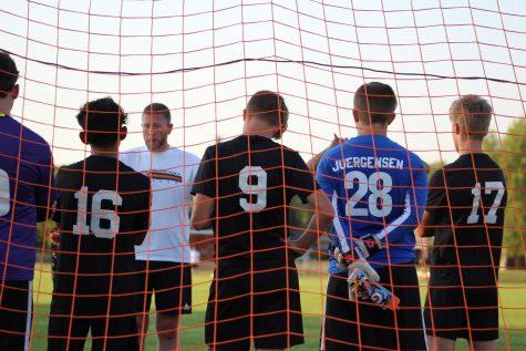 The varsity team strategize during half time against Grayslake North on September 16.