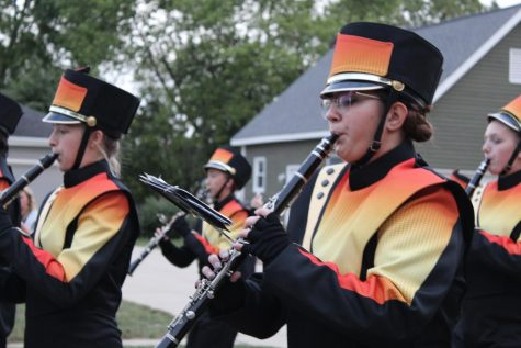 The marching band leads the varsity football team toward McCracken Field before the first home game of the season on September 3.