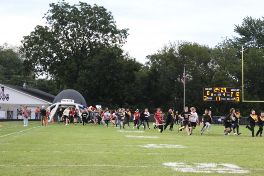 Freshmen run across the football field during the Running of the Warriors before the first home football game of the season on September 3 at McCracken Field.